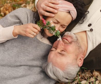 happy-senior-couple-in-love-with-bunch-of-fresh-flowers-in-4148984